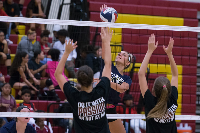 Platt's Vanessa Isyk gets a spike through North Haven's defenders Tuesday during a jamboree at New Britian High School in New Britian Sep. 5, 2017 | Justin Weekes / For the Record-Journal