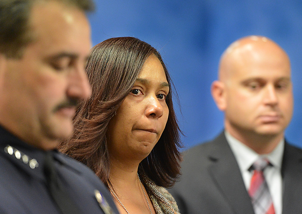 . Tamara Decatur, mother of Kevon Decatur, is flanked by Mark Garcia, Redlands Chief of Police, left, and Detective Dominic Provero during a Wednesday May 21, 2014. Redlands Police are asking for the public�s help finding who killed 22-year-old Kevon Decatur a Moreno Valley resident. Decatur was performing as a rap artist at Cancun Bar and Grill nightclub on Colton Avenue and Tri-City-Center Drive in Redlands Jan. 20, 2013. He was reportedly confronted by three subjects outside the nightclub. (Photo by Rick Sforza/Redlands Daily Facts)