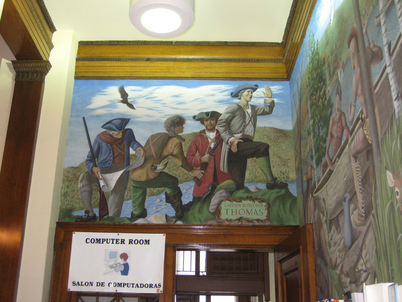 Murals of early explorers, including Rowland Thomas, for whom Mt. Tom is said to be named.   In the 1990's the Computer room replaced the Cataloging and technical services area, which moved upstairs into what had been museum space.  Metal stairs visible in that room once connected the Librarian's Office above with the staff work area below.