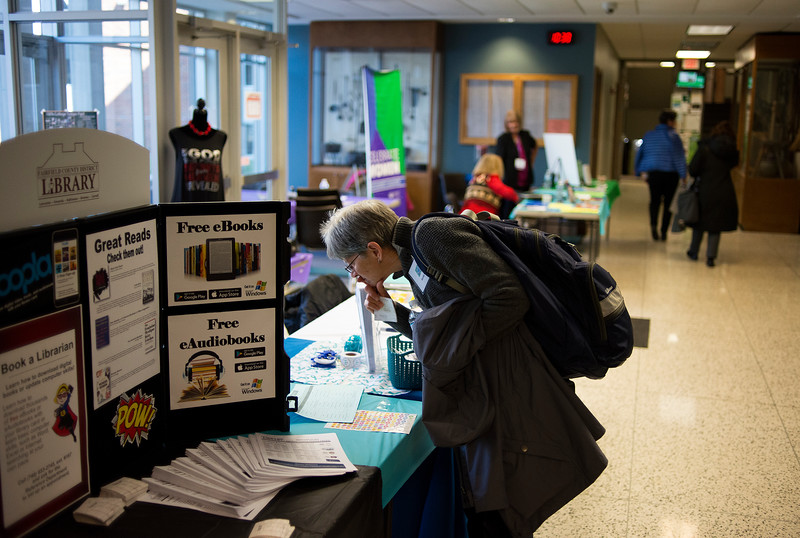 "LANCASTER, OHIO   MARCH 23, 2018: Becky Code, Associate Professor of Anatomical Sciences at the Heritage School of Osteopathic Medicine Dublin Campus, looks of some information at one of the display booths during the Celebrate Women Conference 2018, themed ""Recognizing Our Superpowers"" on March 23, 2018 at Ohio University Lancaster in Lancaster, Ohio.  Ty Wright photo"