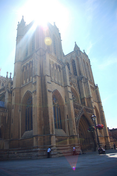 Bristol Cathedral, school boys playing football out front.