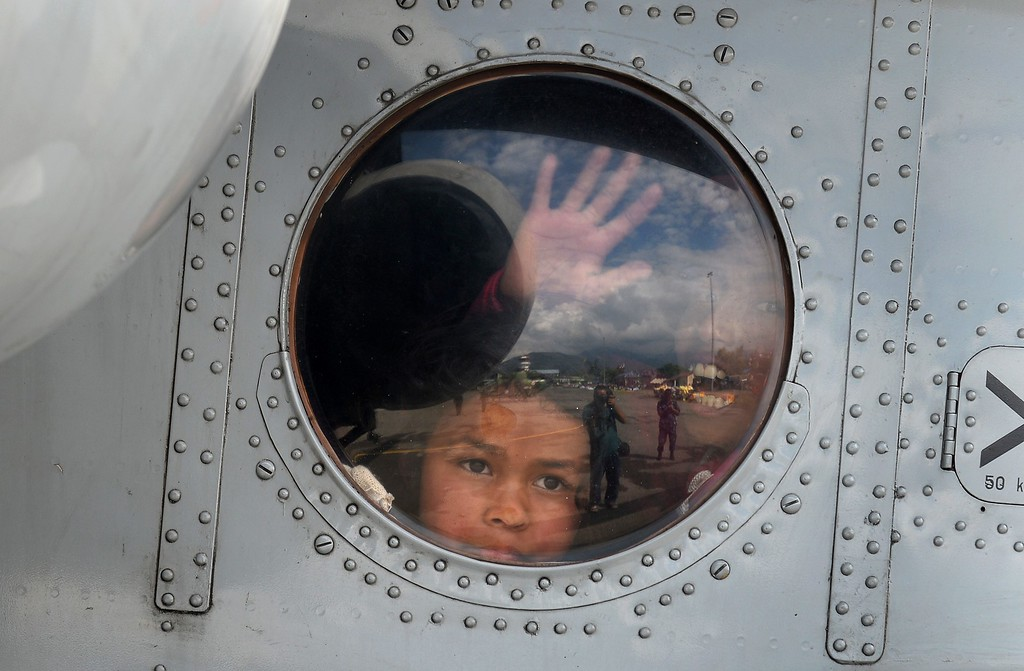 . Nepalese children sit inside an Indian Air Force chopper after they were rescued from an earthquake-hit village, at Pokhara airport on April 30, 2015.  The UN launched an appeal for Nepalese quake survivors in dire need of shelter, food and medical care April 30 as anger boiled at the government\'s inability to cope with a disaster that has killed more than 5,000 people.  AFP PHOTO / SAJJAD  HUSSAIN/AFP/Getty Images