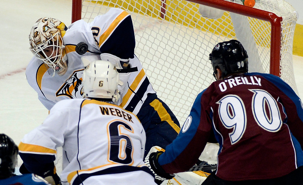 . Nashville Predators goalie Carter Hutton (30) makes a save on  a shot by Colorado Avalanche center Ryan O\'Reilly (90) during the second period November 6, 2013 at Pepsi Center. (Photo by John Leyba/The Denver Post)