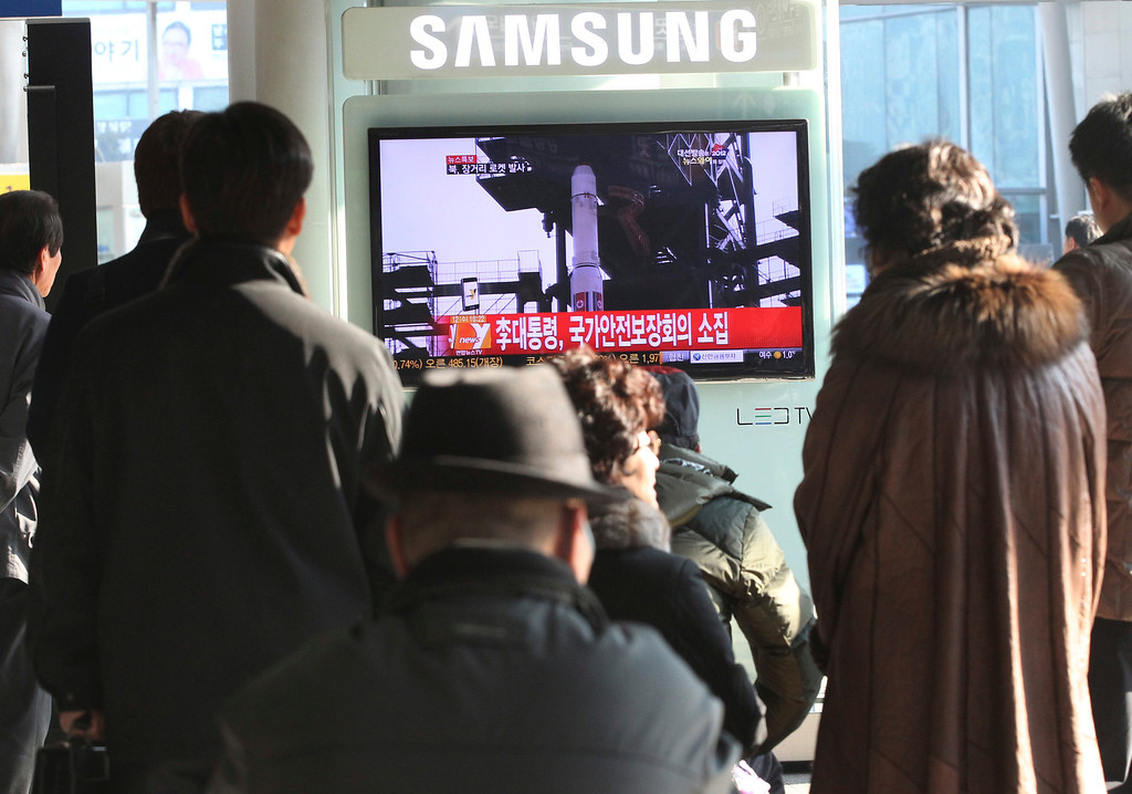 ". South Koreans watch public TV reporting a news about North Korea\'s rocket launch at Seoul Railway Station in Seoul, South Korea, Wednesday,  Dec. 12, 2012. North Korea fired a long-range rocket Wednesday in its second launch under its new leader, South Korean officials said, defying warnings from the U.N. and Washington only days before South Korean presidential elections. The letters on the screen read ""  President Lee Myung-bak convened an emergency meeting of the National Security Council. \"" (AP Photo/Ahn Young-joon)"