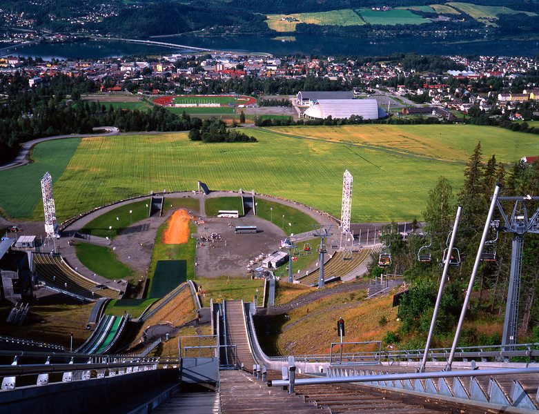 This is the view from the top of the Big Hill in Lillehamer Norway. Notice the artificial turf on the Little Hill to the left. There were jumpers skiing the Little Hill in early August.