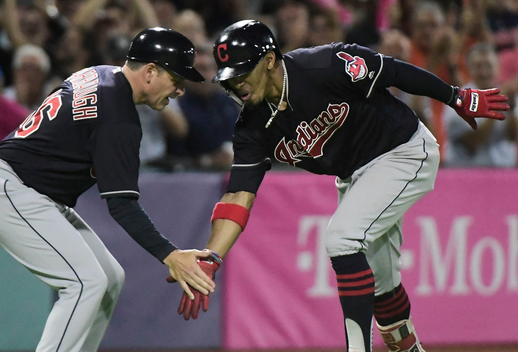 . CORRECTS CINCINNATI TO CLEVELAND AND ADDS MINNESOTA TWINS - Cleveland Indians\' infielder Francisco Lindor, right, celebrates his home run against the Minnesota Twins during the fifth inning of game one of a two-game MLB Series at Hiram Bithorn Stadium in San Juan, Puerto Rico, Tuesday, April 17, 2018. (AP Photo/Carlos Giusti)