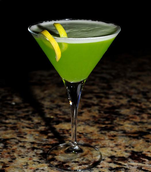 Green Tea ÍStini Ingredients: 0.5 oz. ÍS Vodka 1.5 oz. Cooled Green Tea 0.5 tsp Honey Squeeze of Lemon Lemon Twist for Garnish  Photograph by Mark Bowers for iS Vodka Shot at Nora's, 6020 W Flamingo Rd