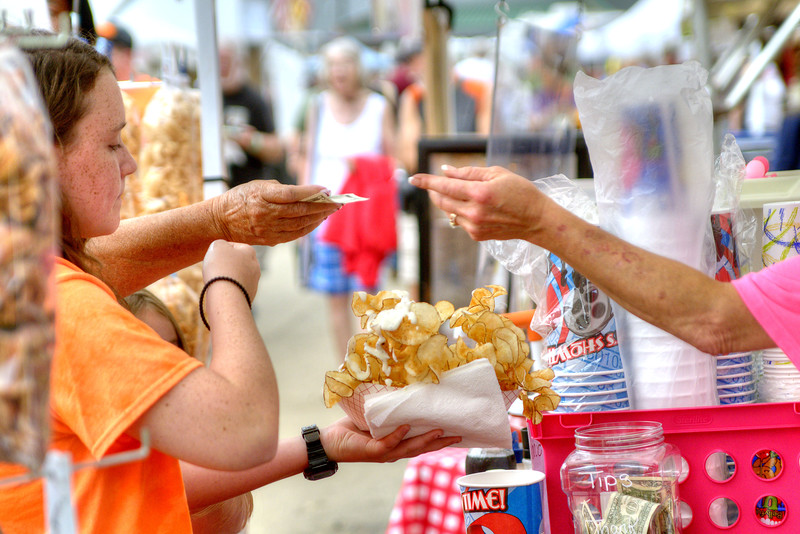 A woman orders a giant basket of chips during the 78th Annual Old Fiddlers' Convention in Galax, VA on Saturday, August 10, 2013. Copyright 2013 Jason Barnette