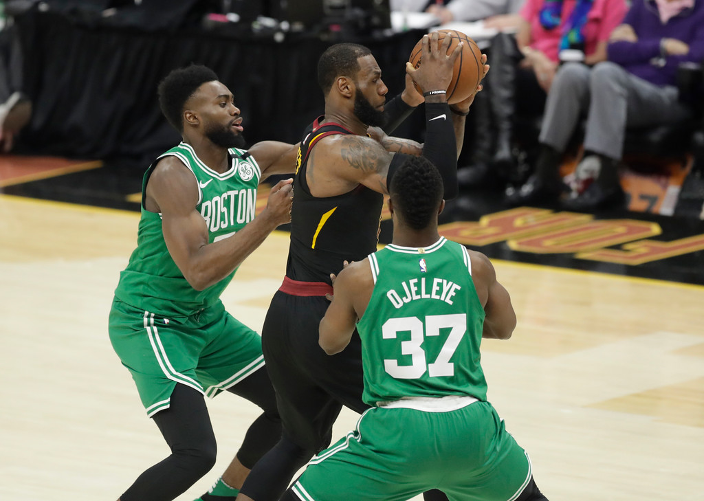 . Boston Celtics\' Semi Ojeleye (37) and Boston Celtics\' Jaylen Brown, left, double-team Cleveland Cavaliers\' LeBron James, center, in the second half of Game 3 of the NBA basketball Eastern Conference finals, Saturday, May 19, 2018, in Cleveland. (AP Photo/Tony Dejak)