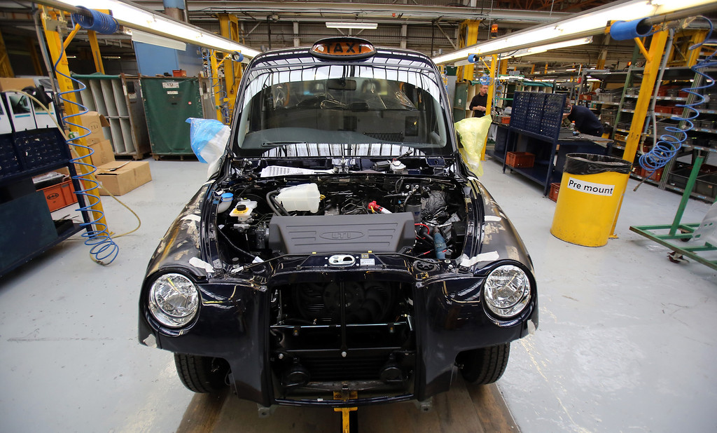 . A  TX4 (Euro 5) London Taxi is seen on the production line in the factory of The London Taxi Company on September 11, 2013 in Coventry, England.   (Photo by Matt Cardy/Getty Images)