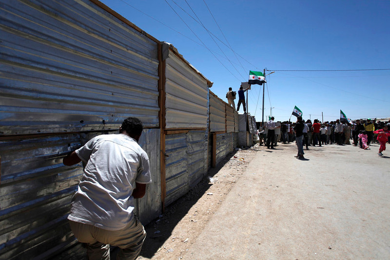 . A Syrian refugee shuts his makeshift shop, during a strike at Zaatari refugee camp, in Mafraq, Jordan, Thursday, April 25, 2013. Several hundred Syrians in a Jordanian refugee camp near the border are striking to demand an international humanitarian zone be set up in southern Syria to enable their return home. They shuttered shops selling vegetables and cold drinks along the main road in Jordan\'s Zaatari camp for several hours on Thursday, in the first of what they said would be daily strikes. (AP Photo/Mohammad Hannon)