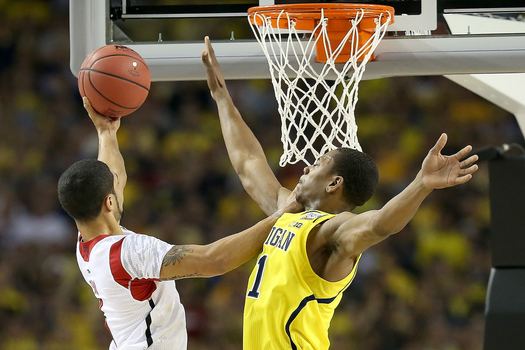 . Peyton Siva #3 of the Louisville Cardinals drives for a shot attempt in the first half against Glenn Robinson III #1 of the Michigan Wolverines during the 2013 NCAA Men\'s Final Four Championship at the Georgia Dome on April 8, 2013 in Atlanta, Georgia.  (Photo by Streeter Lecka/Getty Images)