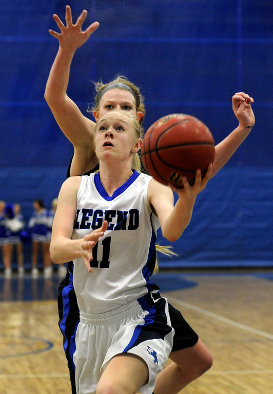 . PARKER, CO. - FEBRUARY 15: Legend forward Joey Sale (11) drove the lane in the first half. The Legend High School girls\'s basketball team hosted Highlands Ranch Friday night, February 15, 2013. (Photo By Karl Gehring/The Denver Post)