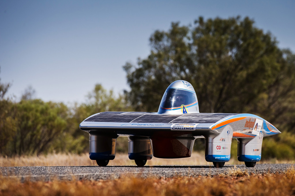 . In this photo taken on Tuesday, Oct. 8, 2013, the Indupol One of the Belgian solar team drives across a desert North of Alice Springs, Australia. The solar challenge race, lasting for seven days, will take 43 participants over 3,021 kilometers before ending on Sunday, Oct 13. (AP Photo/Geert Vanden Wijngaert)