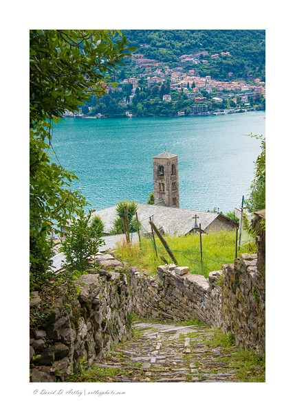 Church bell tower along walking path, Lake Como, Italy