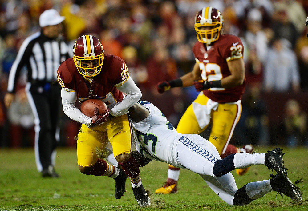 . Santana Moss #89 of the Washington Redskins is tackled by  Marcus Trufant #23 of the Seattle Seahawks as he gets a first down during the NFC Wild Card Playoff Game at FedExField on January 6, 2013 in Landover, Maryland.  (Photo by Patrick McDermott/Getty Images)