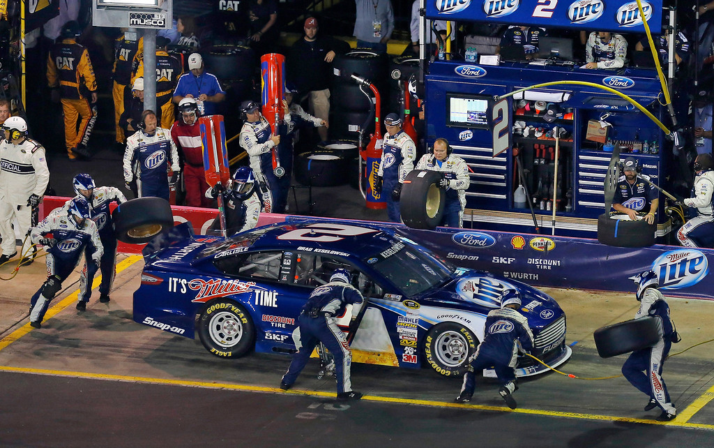 . Brad Keselowski pulls in for a pit stop during the NASCAR Sprint Cup Series auto race at Charlotte Motor Speedway in Concord, N.C., Saturday, Oct. 12, 2013. Keselowski won the race. (AP Photo/Chris Keane)