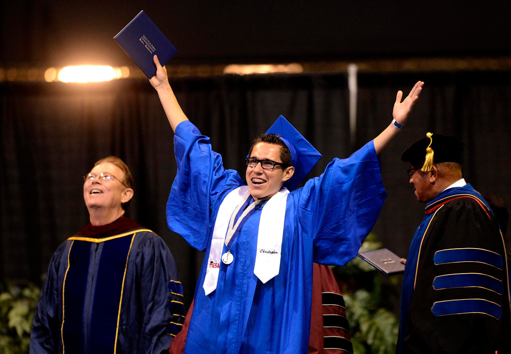 . Christopher Martinez, 18, of San Bernardino, reacts as he receives his diploma during Rialto High School Commencement Exercises held at Citizens Bank Arena in Ontario June 2, 2013. GABRIEL LUIS ACOSTA/STAFF PHOTOGRAPHER.