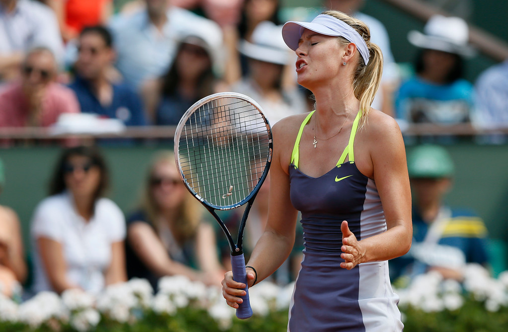 . Russia\'s Maria Sharapova reacts after a point against USA\'s Serena Williams during the 2013 French tennis Open final at the Roland Garros stadium in Paris on June 8, 2013. AFP PHOTO / PATRICK KOVARIK/AFP/Getty Images