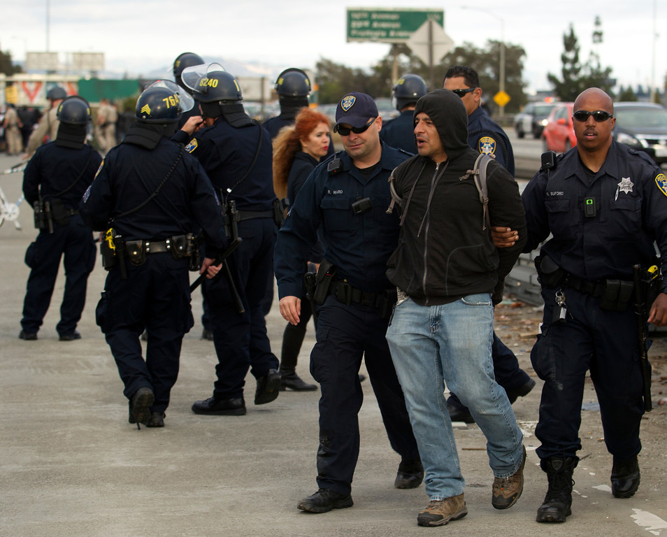 . Oakland, Calif. police arrest a demonstrator who was blocking traffic on Interstate Highway 880 during a protest of the verdict in the Trayvon Martin murder trial last Saturday in Sanford, Fla., Monday, July 15, 2013 in Oakland, Calif. (D. Ross Cameron/Bay Area News Group)
