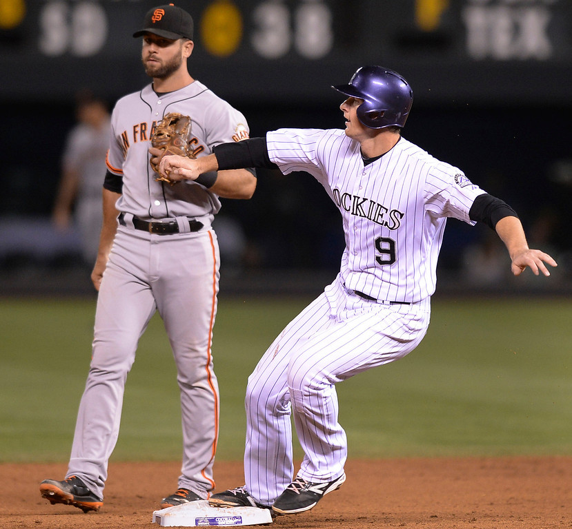 . Colorado baserunner DJ LaMahieu looked at going to third on a single by Brandon Barnes in the eighth inning. The Colorado Rockies hosted the San Francisco Giants Wednesday night, May 21, 2014.  (Photo by Karl Gehring/The Denver Post)