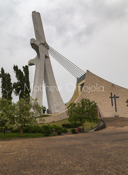 St. Paul's Roman Catholic Cathedral Abidjan Cote d'Ivoire, Ivory Coast.   A large crucifix spire on the left is the face of the cathedral. It connects to the roof by cables.