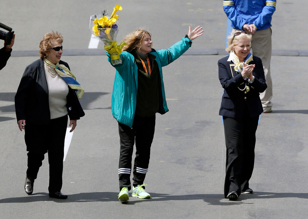 . Bobbi Gibb, first woman to run the Boston Marathon in 1966, waves to the crowd at the finish line of the 120th Boston Marathon on Monday, April 18, 2016, in Boston. (AP Photo/Charles Krupa)