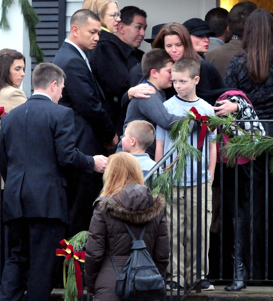 Description of . Mourners stand in line at the Honan Funeral Home in Newtown on 12/17/2012 for the funeral service of six-year-old Jack Pinto, a victim of the Sandy Hook Elementary School shootings. Photo by Arnold Gold/New Haven Register