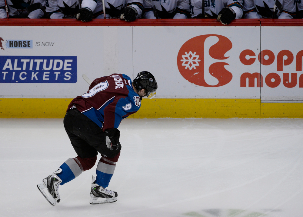 . Colorado Avalanche center, Matt Duchene, skates back to the bench moments after getting colliding with Jamie McGinn,  early in the first period against the San Jose Sharks Saturday afternoon at the Pepsi Center March 29, 2014. Duchene sat the bench momentarily and then headed into the locker room a knee injury. (Photo By Andy Cross / The Denver Post)
