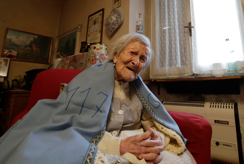 . Emma Morano wears a sheet reading 117,  in the day of her birthday in her home in Verbania, Italy, Tuesday, Nov. 29, 2016.  At 117 years of age, Emma is now the oldest person in the world and is believed to be the last surviving person in the world who was born in the 1800s, coming into the world on Nov. 29, 1899. (AP Photo/Antonio Calanni)