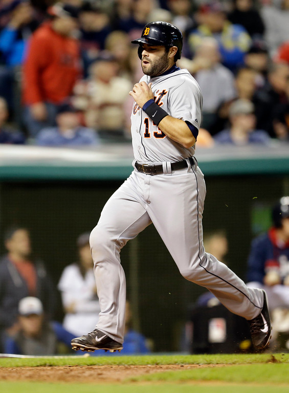 . Detroit Tigers\' Alex Avila scores on Rajai Davis\'s double in the seventh inning of a baseball game against the Cleveland Indians, Monday, May 19, 2014, in Cleveland. (AP Photo/Tony Dejak)