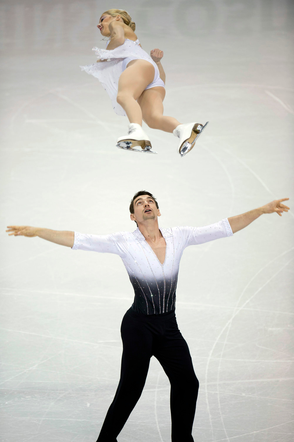 . Alexa Scimeca and Chris Knierim of the United States perform the pairs short program at the World Figure Skating Championships in London, Ontatio, on Wednesday, March 13, 2013. (AP Photo/The Canadian Press, Frank Gunn)