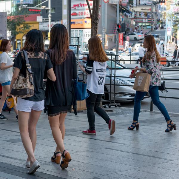 Women walking on sidewalk, Gangnam District, Seoul, South Korea