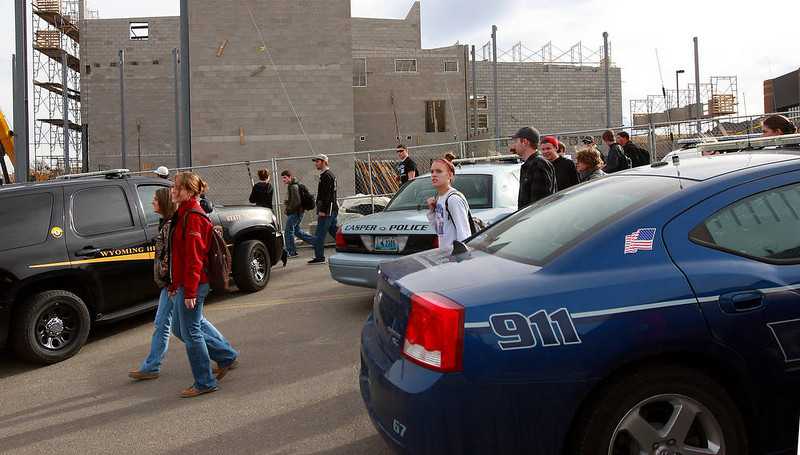 . Casper College students try to reach their vehicles after the campus was released from lockdown due to a reported homicide on Friday morning, Nov. 30, 2012, in Casper, Wyo. At least one person was killed and another was wounded Friday in an attack at Casper College, a community college in central Wyoming. It happened around 9 a.m., said school spokesman Rich Fujita.  (AP Photo/Casper Star-Tribune, Alan Rogers) TRIB.COM