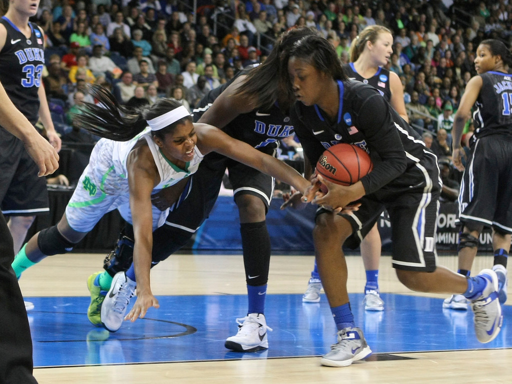 . Notre Dame forward Ariel Braker (44) reaches in as Duke guard Alexis Jones, right, tries to control a rebound during the first half of the regional final game of the NCAA women\'s college basketball tournament Tuesday, April 2, 2013, in Norfolk, Va. (AP Photo/Jason Hirschfeld)