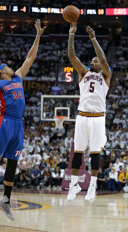 . Cleveland Cavaliers\' J.R. Smith (5) shoots over Detroit Pistons\' Tobias Harris (34) during the first half in Game 2 of a first-round NBA basketball playoff series, Wednesday, April 20, 2016, in Cleveland. The Cavaliers won 107-90. (AP Photo/Tony Dejak)