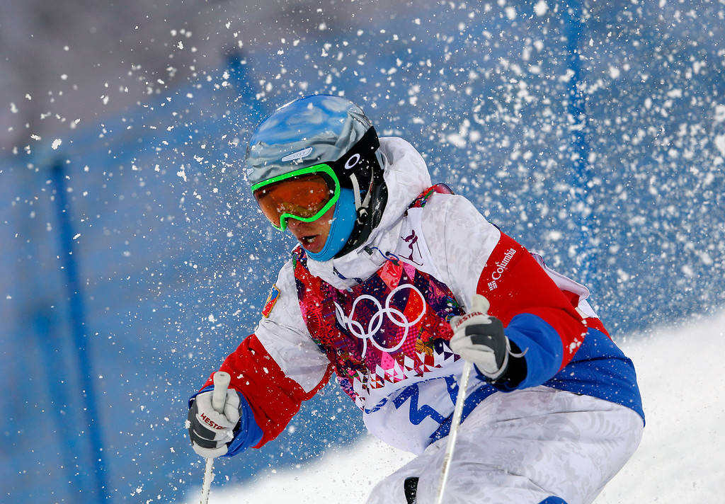 . Russia\'s Andrey Volkov competes in the men\'s moguls qualifying at the Rosa Khutor Extreme Park at the 2014 Winter Olympics, Monday, Feb. 10, 2014, in Krasnaya Polyana, Russia.  (AP Photo/Sergei Grits)