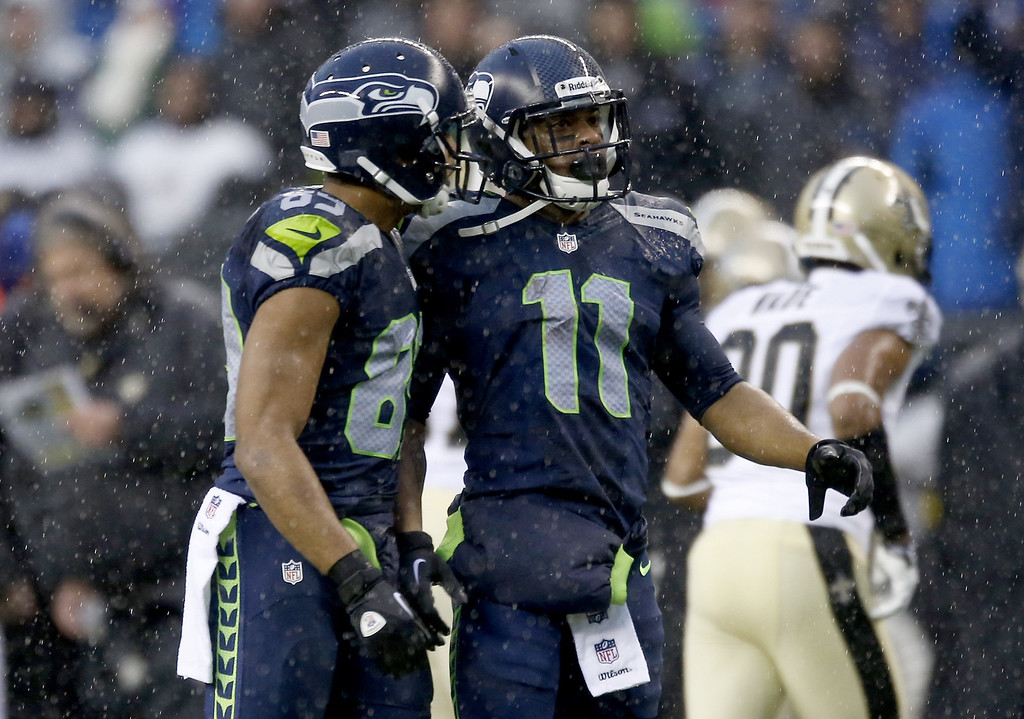 . SEATTLE, WA - JANUARY 11:  Wide receiver Doug Baldwin #89 and wide receiver Percy Harvin #11 of the Seattle Seahawks talk in the second quarter against the New Orleans Saints during the NFC Divisional Playoff Game at CenturyLink Field on January 11, 2014 in Seattle, Washington.  (Photo by Otto Greule Jr/Getty Images)
