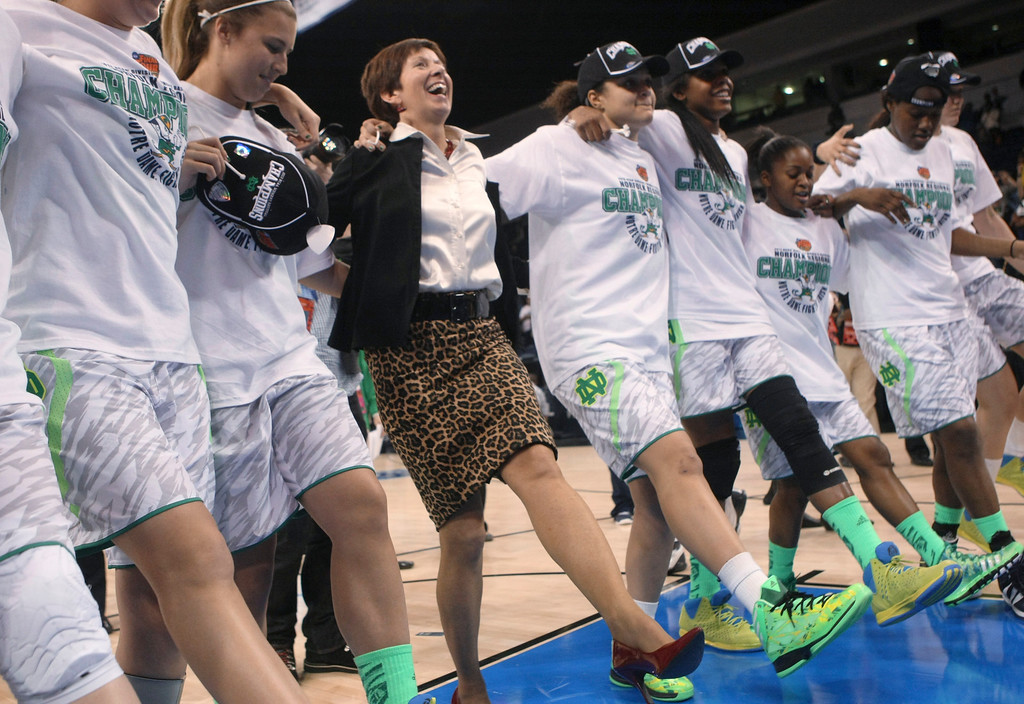 . Notre Dame coach Muffet McGraw, center, dances with her players as they celebrate an 87-76 win over Duke in the regional final of the NCAA women\'s college basketball tournament Tuesday, April 2, 2013, in Norfolk, Va. (AP Photo/Jason Hirschfeld)