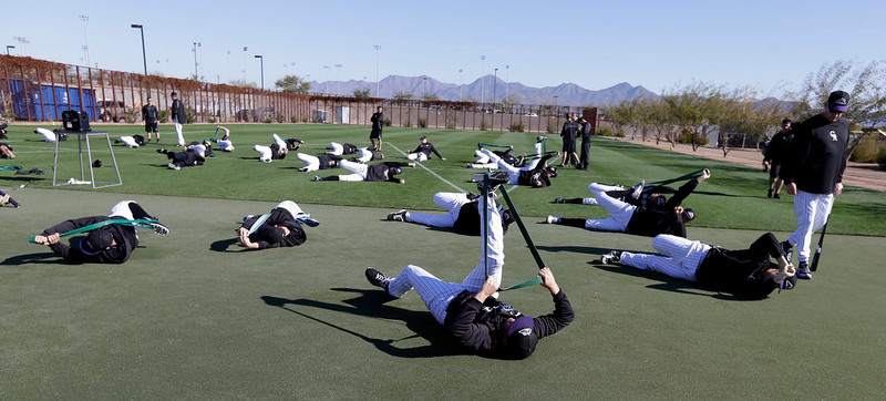 . Colorado Rockies pitchers and catchers stretch before a spring training baseball workout Tuesday, Feb. 12, 2013, in Scottsdale, Ariz. (AP Photo/Darron Cummings)