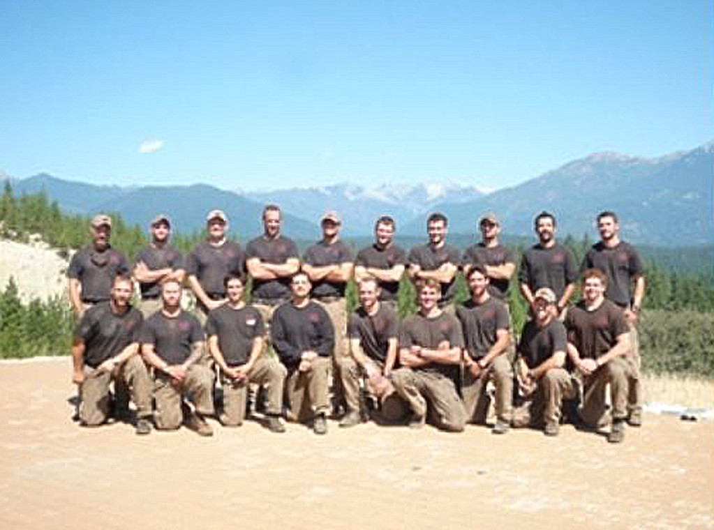 """. This undated picture provided June 30, 2013 courtesy of KPHO-TV/CBS-5-AZ.COM shows the Prescott Granite Mountain Hotshot crew of Prescott, Arizona. 19 hotshot firefighters were killed Sunday battling a fast-moving wildfire in Arizona, in one of the worst incidents of its kind in US history, as flames ravaged homes and forced the evacuation of two towns. The firefighters died while racing to contain the Yarnell Hill wildfire about 85 miles (135 kilometers) north of Phoenix, in what Arizona governor Jan Brewer called \""""as dark a day as I can remember.\"""" The deadly blaze came amid baking temperatures and tinder-dry conditions across the US southwest, with records broken over the weekend in Arizona and California, and follows an already deadly wildfire season across the region.  KPHO-TV/CBS-5-AZ.COM/AFP/Getty Images"""