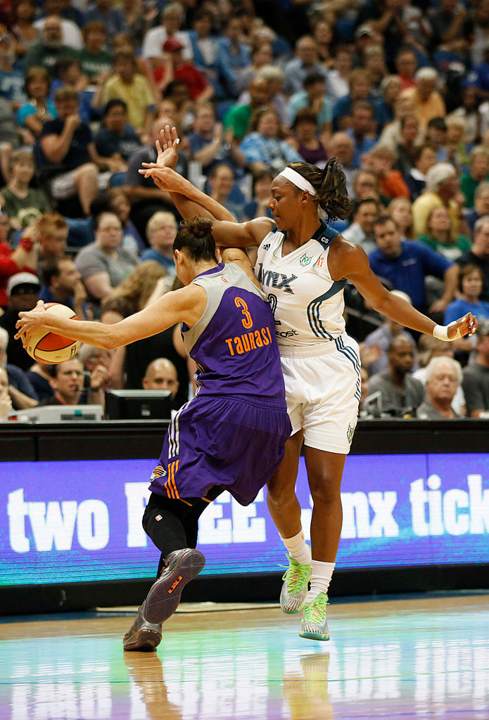 . Minnesota Lynx guard Monica Wright, right,  fouls Phoenix Mercury guard Diana Taurasi, left,  in the first half of a WNBA basketball game. Wright scored 17 points for her team. (AP Photo/Stacy Bengs)