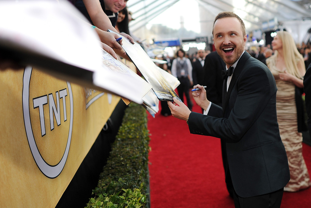 . Aaron Paul signs autographs on the red carpet at the 20th Annual Screen Actors Guild Awards  at the Shrine Auditorium in Los Angeles, California on Saturday January 18, 2014 (Photo by Hans Gutknecht / Los Angeles Daily News)