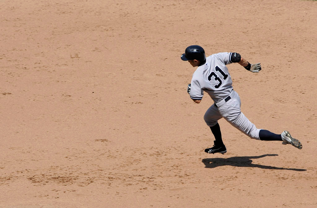. New York\'s Ichiro Suzuki runs toward third base after hitting a two-run triple during the sixth inning.  (Hannah Foslien/Getty Images)