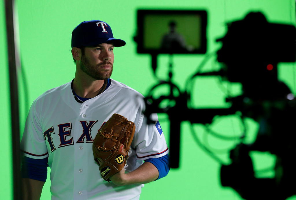 . Texas Rangers starting pitcher Colby Lewis poses for photoghraphers during photo day at baseball spring training  Wednesday, Feb. 20, 2013, in Surprise, Ariz. (AP Photo/Charlie Riedel)