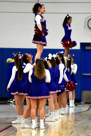 3/5/2019 Mike Orazzi | Staff St. Paul Catholic High School Cheerleaders during the Class S Quarterfinals Girls Basketball Game with Bloomfield Tuesday night.