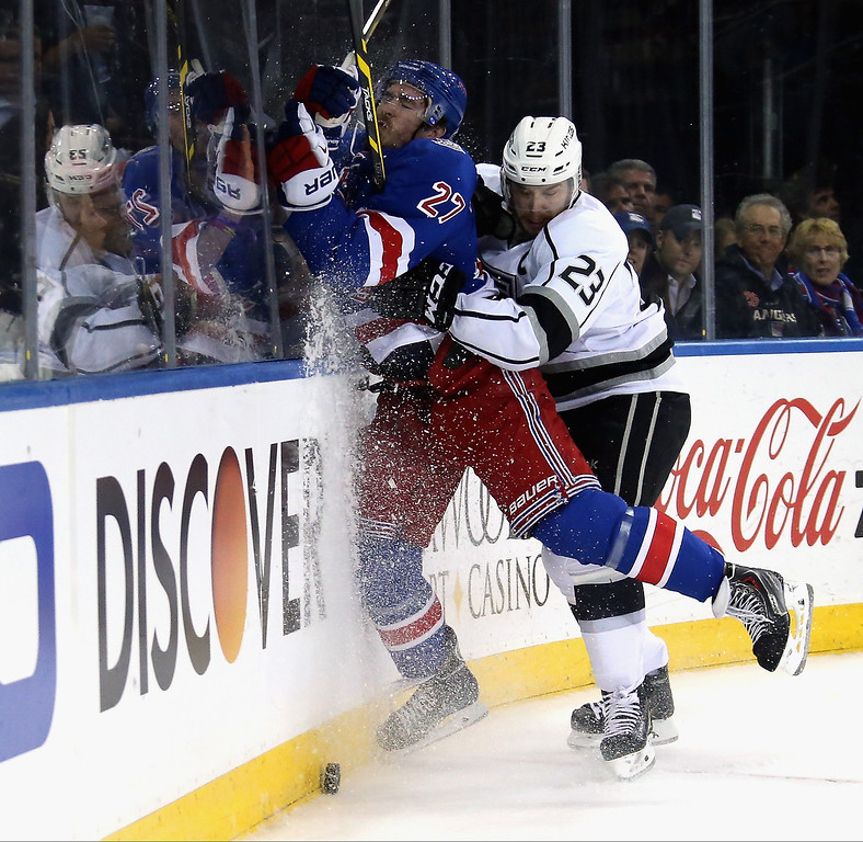 . Dustin Brown #23 of the Los Angeles Kings checks Ryan McDonagh #27 of the New York Rangers during the first period of Game Three of the 2014 NHL Stanley Cup Final at Madison Square Garden on June 9, 2014 in New York, New York.  (Photo by Bruce Bennett/Getty Images)