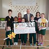 Lynn Cowan from the Childrens Heartbeat Trust accepts a cheque for £759.45 from pupils at St Patrick's PS who raised the money through a Red Day held in the school recently. Also pictured are Roisin Hamill, Principal Ciaran Mackin  and VP Wendy McKeown. R1623002