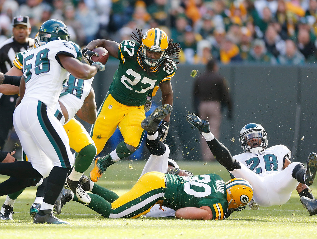 . Eddie Lacy #27 of the Green Bay Packers tries to find running room around the flying Earl Wolff #28 of the Philadelphia Eagles during the first quarter at Lambeau Field on November 10, 2013 in Green Bay, Wisconsin. (Photo by Gregory ShamusGetty Images)