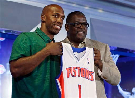 . Free agent guard Chauncey Billups, left, and Detroit Pistons President of Basketball Operations Joe Dumars pose with Billups\' jersey after Billups\' introduction to the media as the newest member of the team at The Palace of Auburn Hills, Mich., Tuesday, July 16, 2013. Billups, who was a member of the Pistons for six years is returning to the team as a player and a mentor to the younger players. (AP Photo/Carlos Osorio)